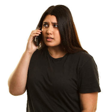 A woman talking on the phone. She looks nervous