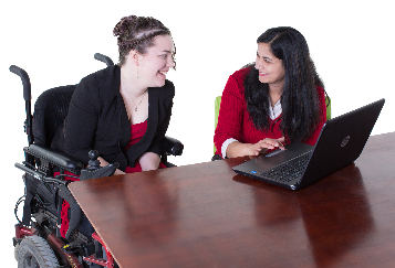 A woman with disability and her mentor looking at a computer
