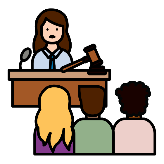 A woman standing behind a bench with a gavel on it, like in a court. There are people sitting in the audience
