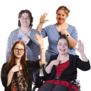 a group of women with intellectual disability with their hands raised