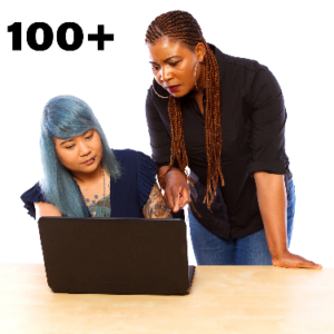 Two women looking at a computer. There is the number 100+ next to them.