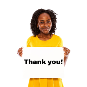 """Woman holding up card that says """"Thank you"""""""